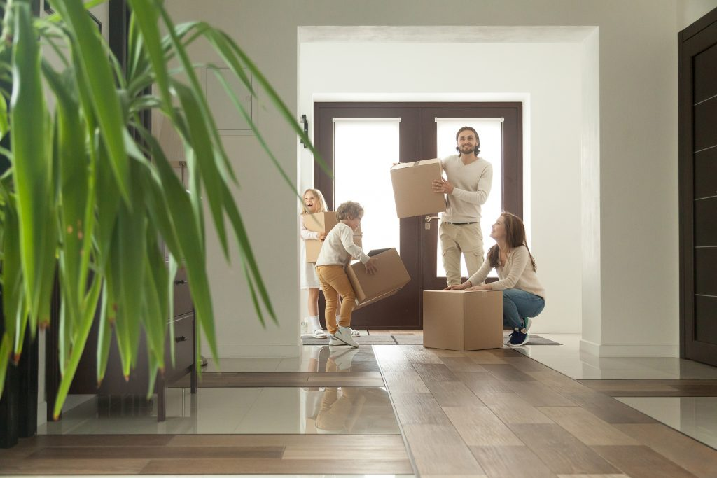 Happy family moving in to new home