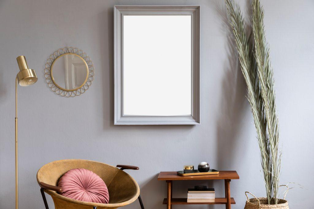 Medium sized mirror in a living room.