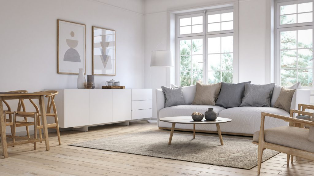 Living room with white colored furniture, a rug, and wooden elements.
